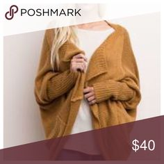 ❣️ ONLY 2 LEFT❣️🎃🏈🍂 20% OFF BUNDLES🎃🏈 😍😍😍 Dolman sleeves knit cardigan in camel. Loose fit. Warm and cozy. Goes with anything and everything. Get it while you can. I am keeping one for myself! Sold out from manufacturer until November. Size large in last pic. Sweaters Cardigans