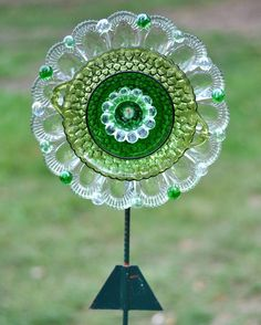 Repurposed Glass Garden Flower, Wall or Garden Art - Made of Vintage Glass Plates, 'IVY' Multi Green Scalloped Glass Flower ……………………………………………… By theglasslotus (Photo Courtesy of Etsy.com)