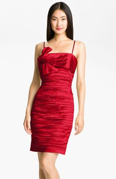 I got the blue version of this dress but red would look gorgeous too! Calvin Klein Ruched Satin Sheath Dress | Nordstrom