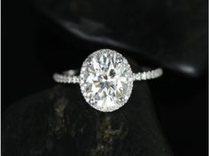 Rosados Box Federella 10x8mm 14kt White Gold Oval FB Moissanite and Diamond Halo Engagement Ring