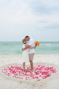 Image Sunshine With Hearts   ... in the sand with a beautiful rose petal heart for the two of you