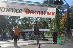 Feeling that sense of accomplishment when crossing the Nutrience Oakville Half Marathon Finish Line!