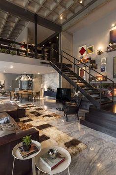Spacious loft living area casa sala com pe direito duplo estilo loft escada preta preto quadro interiores