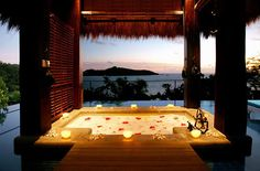 Outdoor bathtub with candles