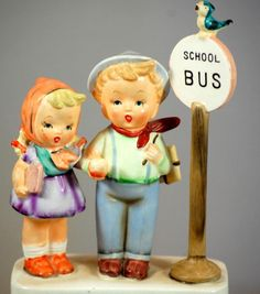 The Vintage Village - View Classified - Hummel Style Vintage Figurine Boy And Girl At Bus Stop
