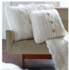 UGG cable knit pillows for Cozy grey creme cream white living room. Silver accents. Pillows