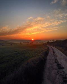 Sunrise on the Camino near Burgos #sunrise #sunriselovers #sunrisephotography #pilgrimage #camino #caminodesantiagopage #caminodesantiago #naturelovers #instanature #nature #sun #dust #clouds #cloudporn #fields #way #hills #destination #ultreia #notallwhowanderarelost #hiking #hikingadventures by krixelpixel73