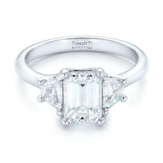 This classically-inspired engagement ring features an emerald cut diamond prong set in the center, with a trapezoid diamond on either side of it atop a platinum band. Designed and created by Joseph Jewelry Design Your Own Engagement Rings, Classic Engagement Rings, Alternative Engagement Rings, Platinum Engagement Rings, Designer Engagement Rings, Diamond Crown Ring, Wedding Bands For Her, Thing 1, Three Stone Rings