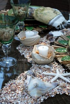 Tommy Bahama setting. Seashells in the shape of the lagoon reef on the table. Candles in sea shells with brown sugar sand. Much more on this blog.