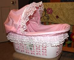 Laundry Basket Bassinet How-To ~ These are laundry baskets decorated to look like baby bassinets and are filled with baby shower gifts! Cute and creative idea... link to tutorial on the