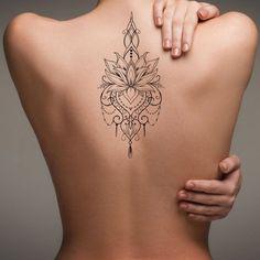 Bohemian Lotus Back Tattoo Ideas for Women - Feminine Tribal Flower Chandelier Jewelry Spine Tat - Ideas de tatuaje de espalda de mujer - www.MyBodiArt.con #tattoos
