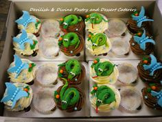 Perfect for a 'Rainforest'-themed event; Bright Butterfly and Snake Cupcakes