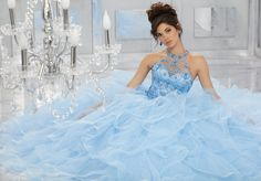 Tulle Quinceañera Dress Featuring a Beautifully Beaded Bodice and High Halter Neckline with a Cascading Ruffle Skirt Trimed in Horsehair. Matching Bolero Jacket Included. Colors Available: Scarlet, Champagne/Blush, Bahama Blue, White.