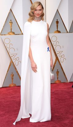 2017 Academy Awards: Karlie Kloss tops off her caped white Stella McCartney gown with Nirav Modi jewelry and an ACLU-supporting blue ribbon.