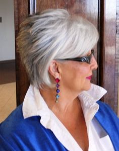 Cute classy natural gray hairstyle. We love this cute short feathered face-framing hair.