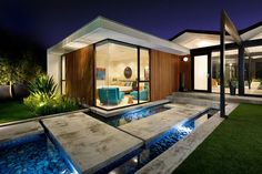 84b936823ad01442355141-Stepping-stones-and-reflecting-pool-shape-the-dazzling-entry-of-the-LA-Home-with-ocean-views1.jpg