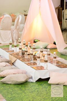 Get your camping outfits ready darlings, because we're going camping... indoors! Party Deco brought a bohemian outdoor set for Megan's birthday party, complete with pink teepees and lots of pillows! So chic, right? Jackie Martinez of Crafty Cakes and Cupcakes made sure there's more than just s'mores to indulge your sweet tooth. Thanks to Tyron Cruz…
