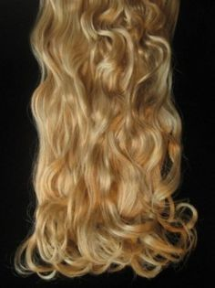 £14.49 - Golden blonde wavy clip in extensions, full head - six 24 wefts : 6 Piece, Full Head, Clips  Wavy, golden blonde (colour Blonde 24) synthetic clip-in hair extensions. There are 6 wefts in a full head. Each weft is 4 inches in width and 24 inches (61cm) long, and has two clips on it to attach it to your hair.