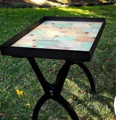 turn a luggage rack into a tray table, painted furniture, repurposing upcycling.   Maybe for a coffee table? Put a map under shadow box like glass and mark everywhere we've traveled to.