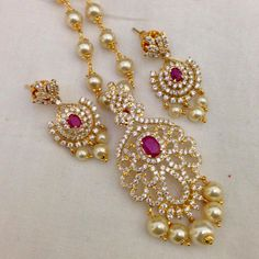 CZ and Ruby pendant with pearl drops and earrings Code : PS 401 Price: Rps. 1395/- Whatsap to 09581193795 for order processing