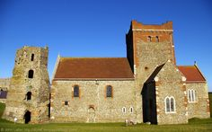 Roman Pharos and Saxon church of St Mary-in-Castro, Harold's Earthwork, Dover Castle, Kent, England, UK. Pharos lighthouse (watch-tower) built 46 AD by Emperor Claudius while Aulus Plautius governor of Britain. Ex-belfry to  pre-1020 AD St Mary-in-Castro King Lucius church (Victorian restorations: Sir George Gilbert Scott, William Butterfield). Listed Building, English Heritage site, Scheduled Ancient Monument. Medieval History. Travel and Tourism. See…