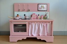 Play kitchen made from an old TV stand