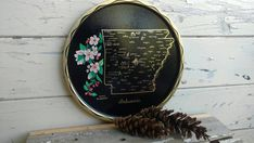 Check out this item in my Etsy shop https://www.etsy.com/listing/479232651/kitsch-arkansas-tray-decorative-vintage