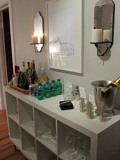 IKEA's Expedit shelves, turned them on their side, and attached four legs to make it a bar/buffet/storage for glassware!