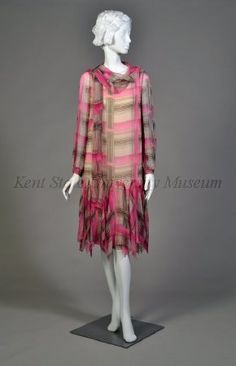 1924-1926 CultureAmerican Day dress silk chiffon prntd in plaid of hot pink,blk,turquoise & orange on a cream ground.Scoop nk with scarf.