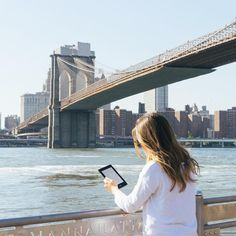 Enjoying my staycation at Brooklyn Bridge park with my @amazonkindle. Be sure to tag your summer travel photos with #haveKINDLEwillTRAVEL for a chance to win a Kindle you can call your own.
