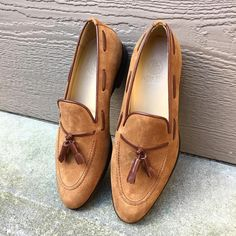 Mid brown suede tasseled loafers. Felix Flair