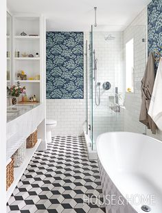 In this daring bathroom by H&H design editor Kai Ethier, a dark blue floral wallpaper and graphic floor tile are buffered with clean white subway tile. | Photographer: Valerie Wilcox