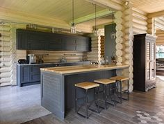 This #home's #kitchen by Lavka Design brilliantly combines elements of #rustic and modern style to produce a unique, casual space. The kitchen has been completely constructed of #wood, with the material emanating an air of #countrystyle, while the storage spaces have been painted a more #contemporary, cobalt #grey. Find more #kitcheninspiration on #homify  #kitchenideas #kitchendesign #modernkitchen #modernliving #moderndesign #interior #moderninterior #rustickitchen