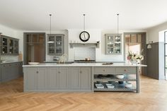 The kitchen's main feature is the big bespoke island made from a combination of standard and bespoke deVOL shaker cupboards, creating a 3 meter long preparation table and breakfast bar.
