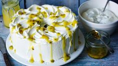 This American cake is incredibly light as it's made with whisked egg whites and no fat. Mary Berry decorates her version with homemade lemon curd and passion fruit seeds.  Equipment and preparation: You will need a 25cm/10in angel food cake pan.