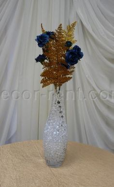 DECOR-RENT.COM - B 20. Centerpiece with gold branches and dark blue roses.