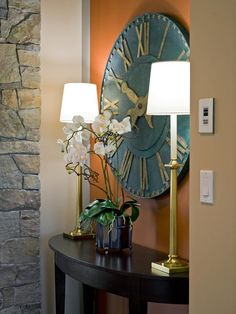 One of many stop-and-pause moments, a decorative vignette at the guest suite entrance reminds visitors that time should be of no consequence in this relaxing modern-rustic ranch home.