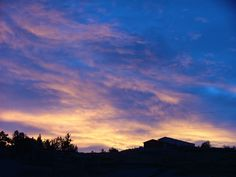 """Natural cloudscape photo taken in Billings, MT.  I call this """"Blue & Gold West Wall"""""""