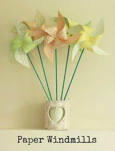 DIY Tutorial: Paper Windmills. These are super cute and perfect for any DIY wedding.