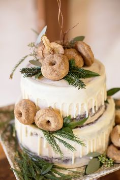 Rustic winter chocolate wedding cake with sugar and cinnamon icing with a white chocolate drizzle - topped with evergreens and cinnamon sugar donuts from Entwined Events Catering | Heather Kidd Photography
