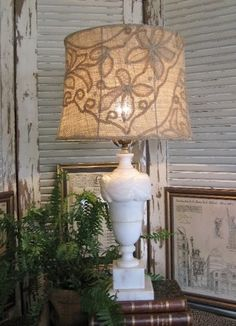 Cover metal lampshade frame with burlap and stitch lace on top