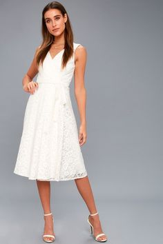 dafbd25033 Lulus exclusive! The romance is real in the Siana White Lace Wrap Midi Dress !