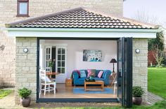 Front view of opened bi fold doors on an everest tiled roof extension kitch Pergola With Roof, Cheap Pergola, Pergola Shade, Patio Roof, Pergola Patio, Pergola Plans, Pergola Ideas, Metal Pergola, Patio Ideas