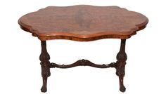 A late 18th Century English walnut veneered occasional table.  The table has a serpentine-shaped walnut top, rosewood thin support platform base with two scroll feet and concealed casters to enable upright support and movement. Between the two upright supports is a serpentine shaped cross rail and carved sculptured design with turned and cabriole legs.  C.1890