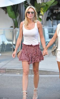 Pins on parade: Alex wore a white vest top with a frilled skirt and caged beige open toe h...