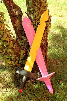 "My DIY cardboard Adventure Time Finn's sword and Fionna's crystal sword after painting. I finished these ""papiermaché"" swords by painting them with acrylics."