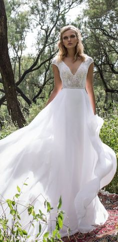Featured Dress: Limor Rosen; Beaded V-neck wedding dress idea.