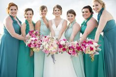 Bridal Party Photos - teal dresses and grey suits - pink bouquets- great pose with the flowers all together - Charleston Crafted