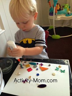 Fine motor skills. Squeeze glue and slide sequence and shapes into the glue.