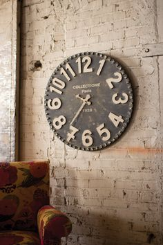 Inspired by antique wall clocks of the old Paris flea market, this rustic time piece is aged to perfection. With its bold white numbers, ornate arms, and old wo